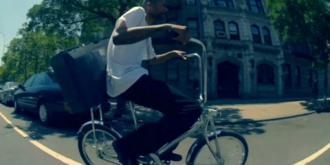 Ruste Juxx on a lowrider, hiphop