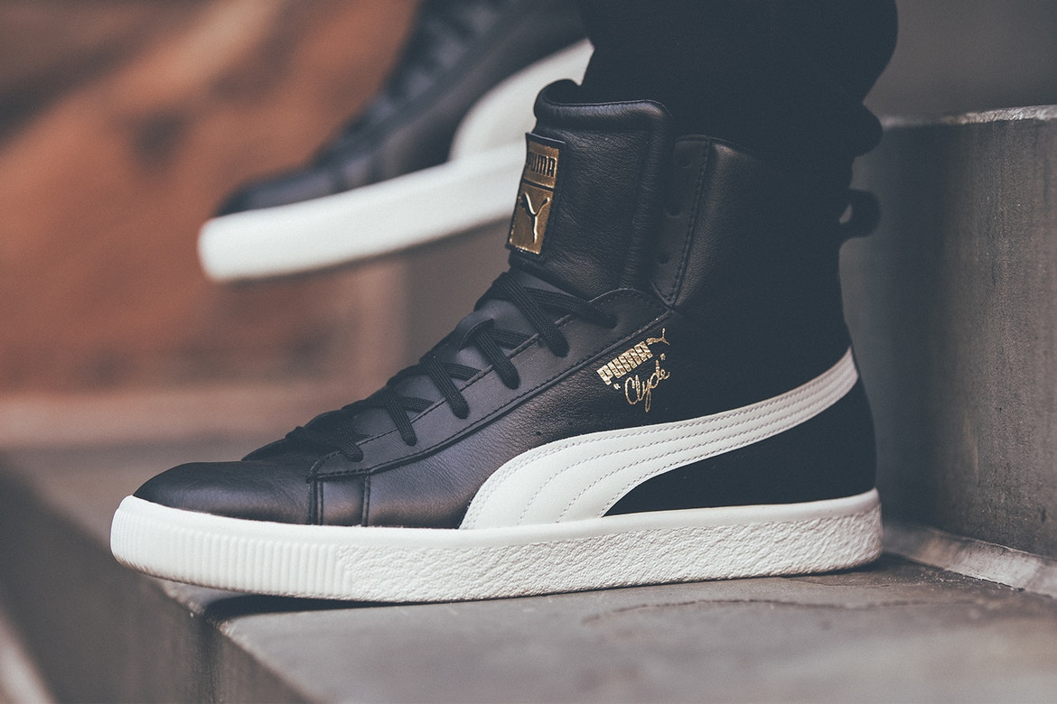 wholesale dealer 1b618 f1af8 PUMA Clyde Mid Foil in White and Black Leather - Sugar Cayne