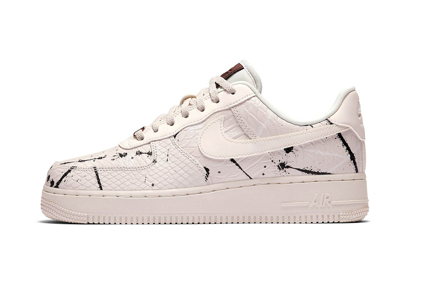 "You can get you feet in a pair of The Nike Air Force 1 ""Phantom Snakeskin"" at select Nike UK locations for £90 GBP (approx $110 USD)."